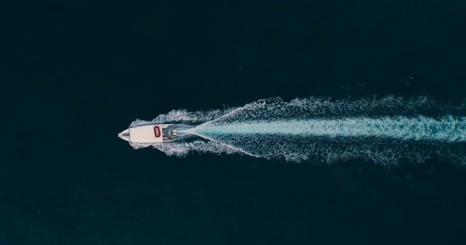 Slow Motion Aerial Drone Shot Over Small Speed Boat Boat Rushing Toward Exotic Caribbean Destination Jamaica Scenic Seascape Traveling To New Destinations Caribbean Vacation Holiday Concept 4k