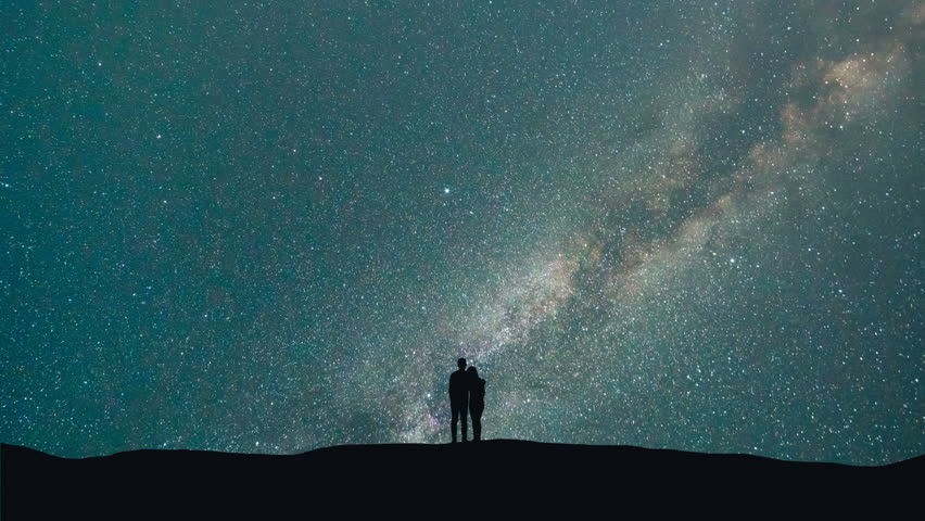 The couple stand against the milky way with asteroids skyfall. time lapse #30148915