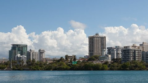 4K Timelapse pan shot right of San Juan Skyline Puerto Rico with clouds on a sunny day