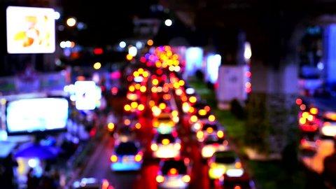 Defocused night traffic lights - Bangkok street in Thailand