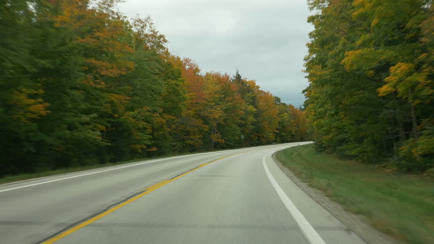 Autumn driving on M-123 (Michigan state route 123) in Luce County, Upper Peninsula, Michigan.