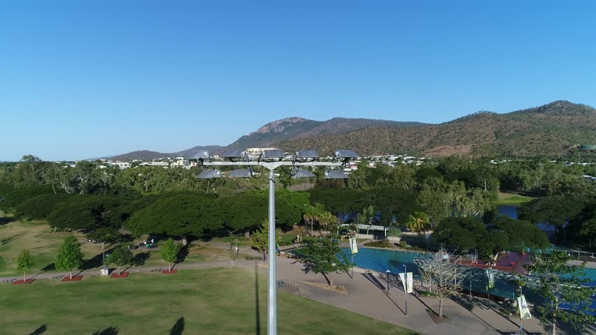 4K Aerial Footage - pan above lightpole at football sports oval - Townsville Queensland Australia - up pan
