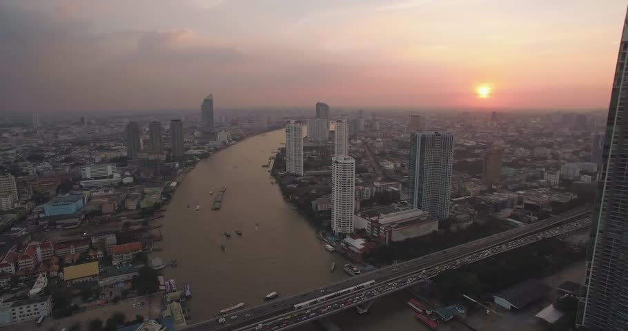Sathorn And Chao Phraya River At Sunset, Bangkok, Thailand, Aerial Pan Shot | Shutterstock HD Video #30255715