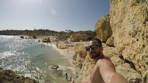 Guy Taking a Selfie in Algarve Beach, Portugal