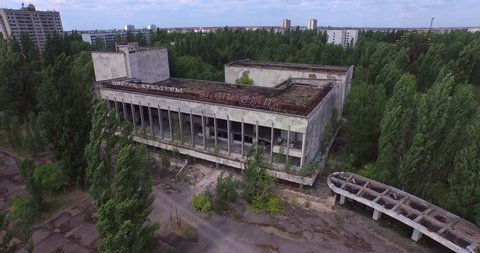 """Chernobyl Exclusion Zone, Ukraine,  - July 12, 2015: Aerial video. Palace of Culture """"Energetik"""" in Pripyat town near Chernobyl, 4K."""