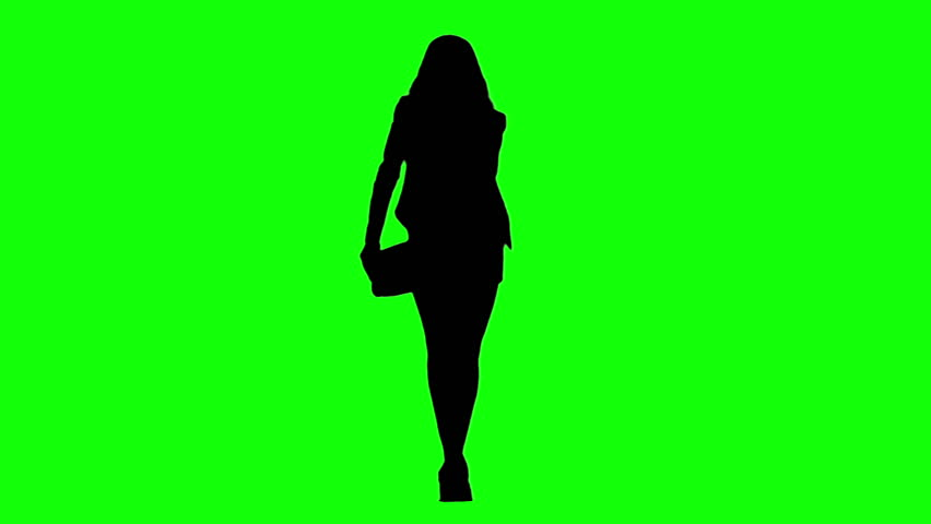 Fashion model girl with bag walking towards the camera in green background, with only a silhouette.
