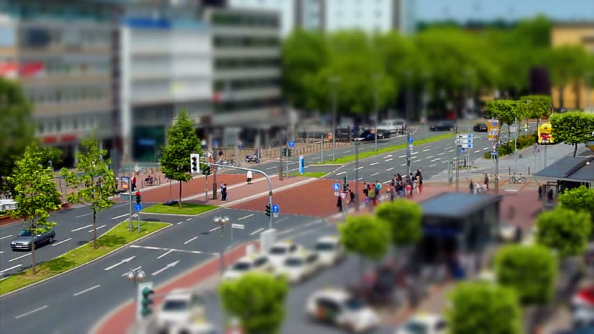 A tilt shift shot of walking people and traffic in the city of Bochum, Germany.