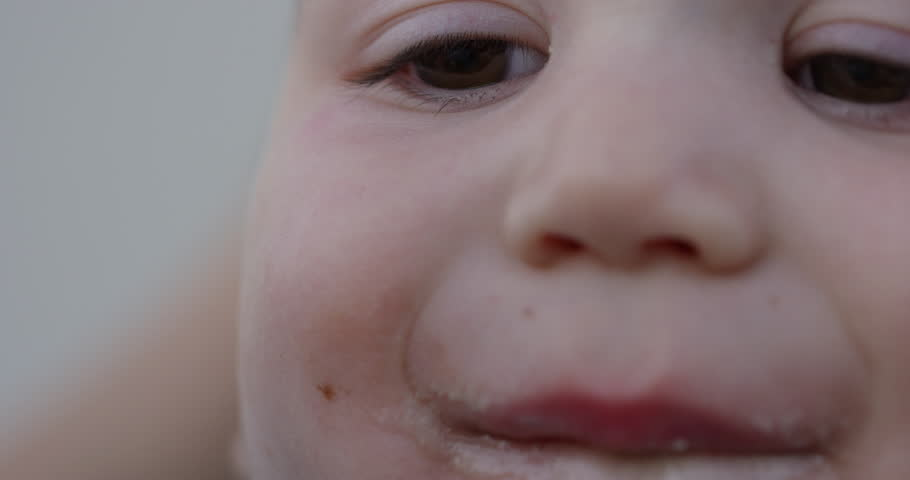 Baby eats icecream off spoon - close up on eyes | Shutterstock HD Video #30362395