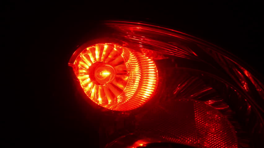Close-up on red brake light on and off. Car stop. Car brake indicator.