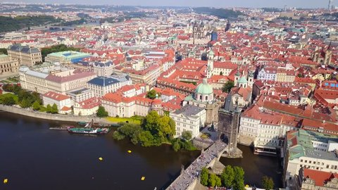 Prague, Czech Republic - Aerial footage of a beautiful summer's day over Charles Bridge and Prague one municipal district - Aerial view