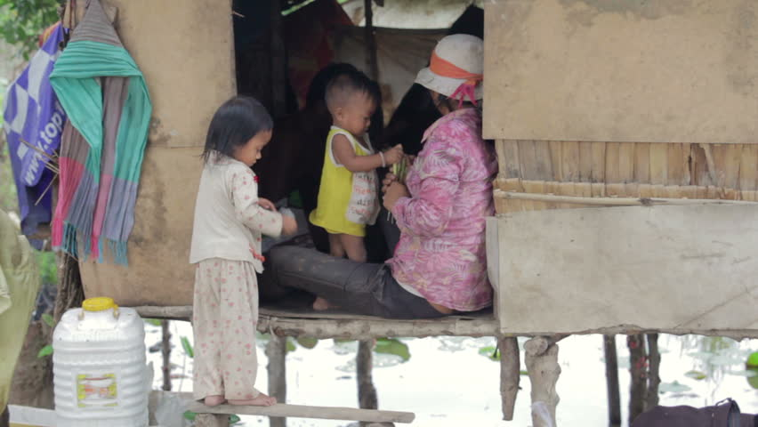 Cambodian family in slum, inside shack