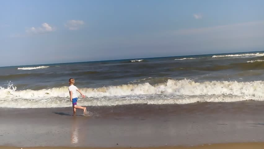 The boy runs along the seashore | Shutterstock HD Video #30446635