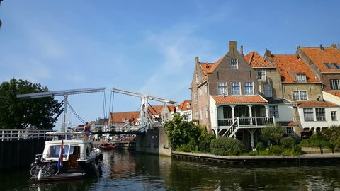 Boat arrives at Enkhuizen harbor and waits for a bridge that opens