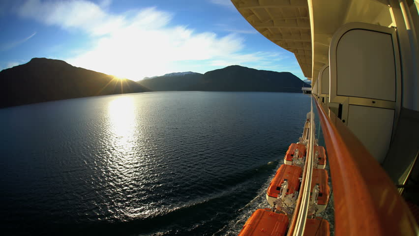View of Cruise Ship at sunrise scenic beauty from balcony of Norwegian Fjords snow capped mountains Sognefjorden Fjord Scandinavia Europe   Shutterstock HD Video #30461371