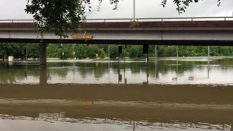 Water has completely flooded an underpass and is now flowing into Buffalo Bayou after Hurricane Harvey.