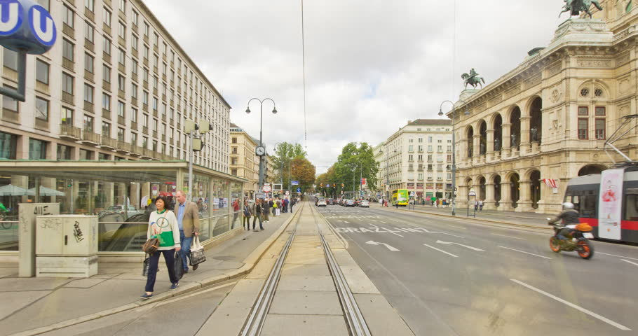 VIENNA, AUSTRIA - SEPTEMBER 2017: Hyperlapse time-lapse out of moving tram line number 71. Sightseeing tour along the famous Ringstrasse until Rennweg with popular historic sights.