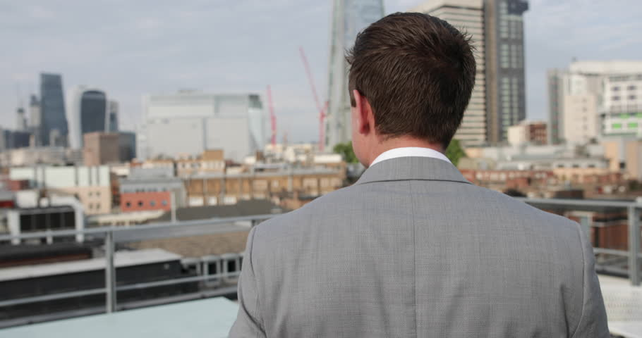 Businessman looking out at London city skyline | Shutterstock HD Video #30499975