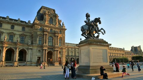 PARIS, FRANCE - JULY 1, 2017: Lead copy of Bernini Equestrian Statue of King Louis XIV in the square of Louvre Museum Palace by the Denon Wing containing Leonardo da Vinci's masterpiece Mona Lisa.