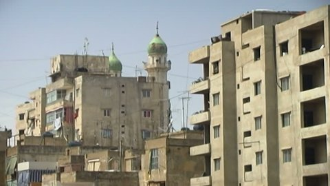 BEIRUT, LEBANON - CIRCA 2005: View of a mosque and residential buildings in Dahieh, which is a predominantly Shia Muslim suburb. The area is the Beirut stronghold of Shiite Islamist group Hezbollah.