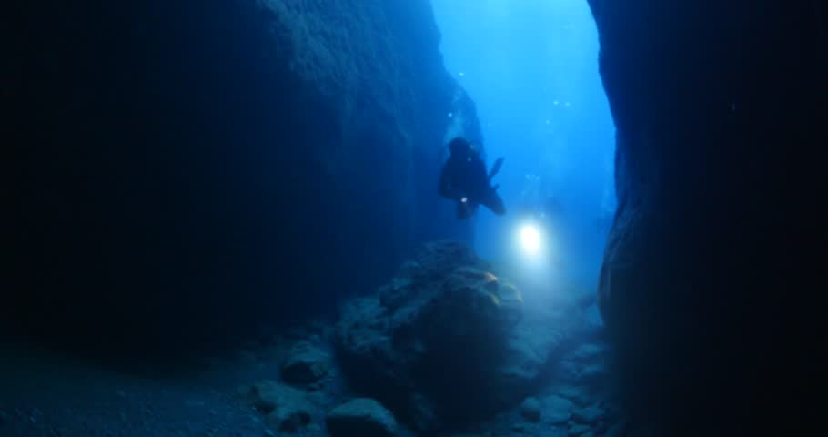 cave diving underwater scuba divers exploring cave dive