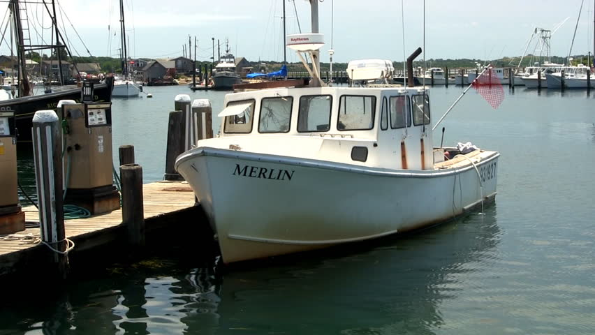MENEMSHA HARBOR, MARTHA'S VINEYARD - JULY 14th;  Fishing boat waits at gas pump before heading out to sea from quaint fishing village July 14th, 2012 MENEMSHA, MA