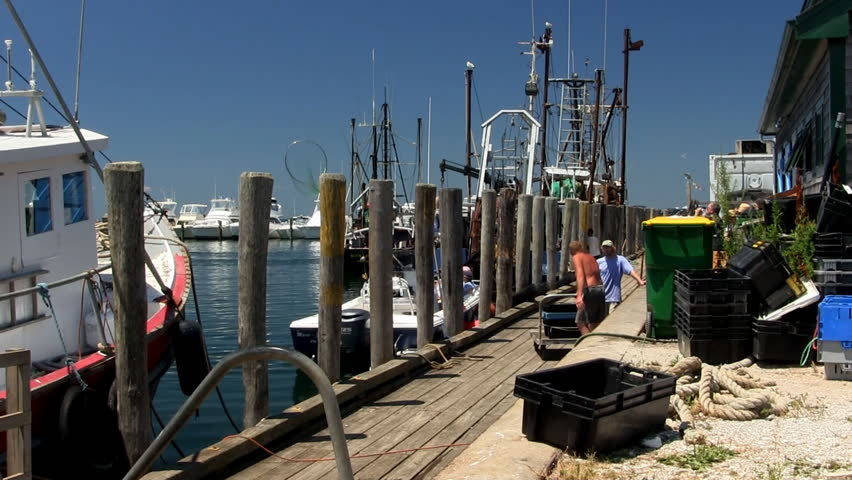 MENEMSHA HARBOR, MARTHA'S VINEYARD - JULY 14th;  Fisherman unload their catch for restaurants along the dock of quaint fishing village July 14th, 2012 MENEMSHA, MA