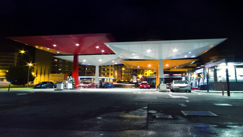 SPAIN - CIRCA 2012: Time lapse of several cars filling fuel at gas station at