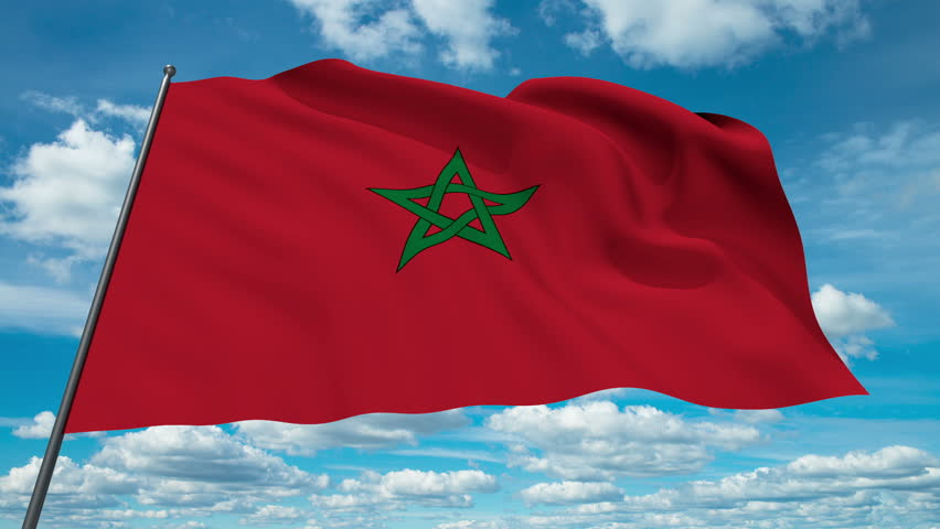 Marocco flag waving against time-lapse clouds background