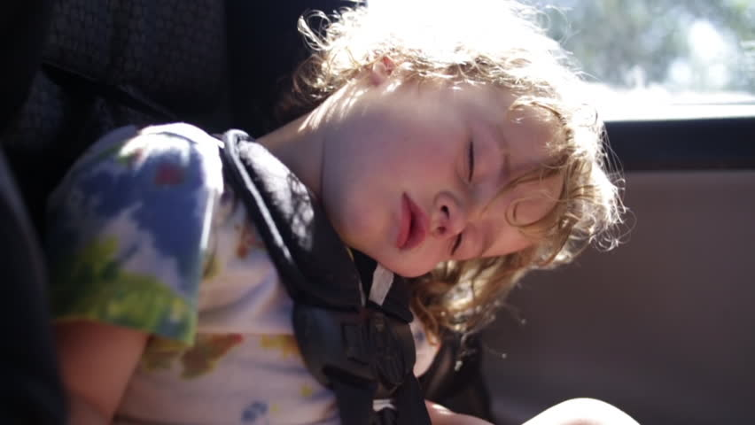 Cute Curly Haired Boy Sleeps In His Car Seat (Slow Motion Closeup)