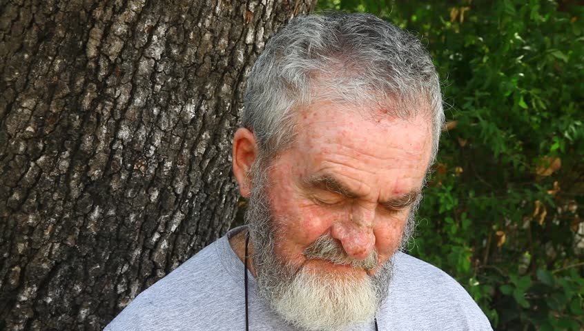 Old senior man sits and talks in the park | Shutterstock HD Video #3058495