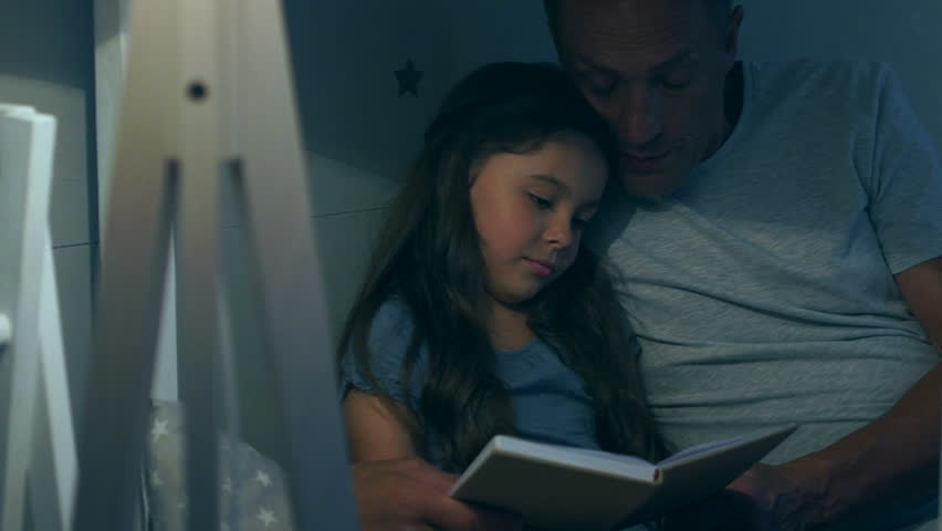 Caring father reading a book with his little daughter | Shutterstock HD Video #30606115