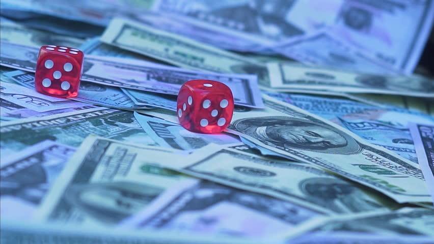 Red dice falling on money | Shutterstock HD Video #30613105