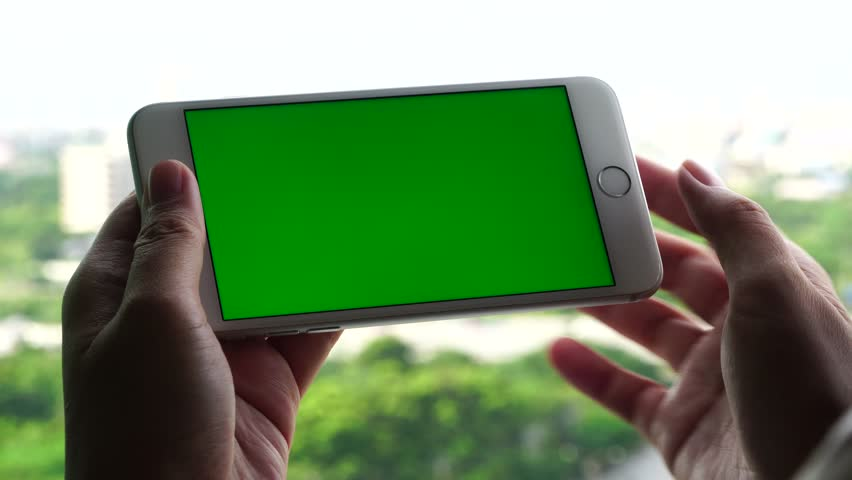 Bangkok, Thailand, SEP 07, 2017: close up woman uses white iphone 7 plus apple mobile phone white background Smartphone on green screen display with chroma key electronic device editorial 4K editorial | Shutterstock HD Video #30619615