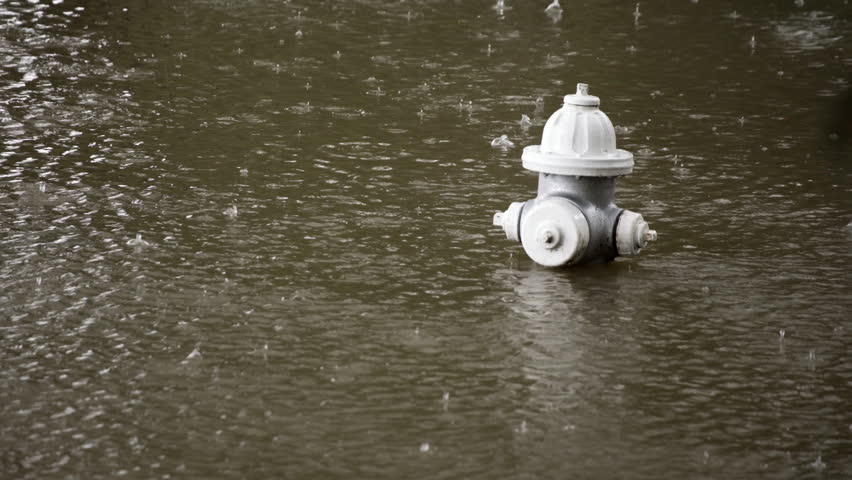 fireplug showing how flooded a street is during hurricane harvey