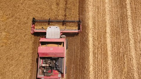 Nikolaev, Ukraine - June 29, 2017:Exciting bird`s eye view of a modern combine harvester gathering ripe wheat in Ukraine in on a sunny day in summer.