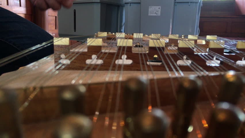 In Selective Focus of closeup Woman Wearing Jeans During Playing the Dulcimer Thai Music.Thai musical instruments.  | Shutterstock HD Video #30680035