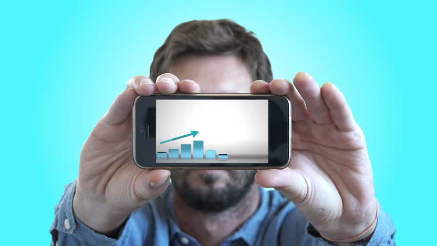 Successful Person Holding Smartphone With Positive Chart Animation. Man holding a smartphone with a positive chart in a business presentation | Shutterstock HD Video #30685375