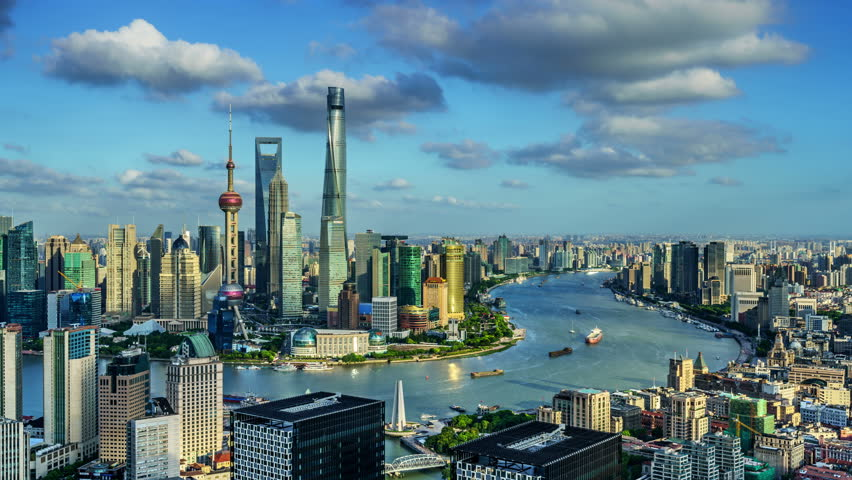 "Zoom in timelapse: Shanghai skyline,China. Aerial view of high-rise buildings with Huangpu River. >>> Please search more similar: ""ShanghaiSkyline""  