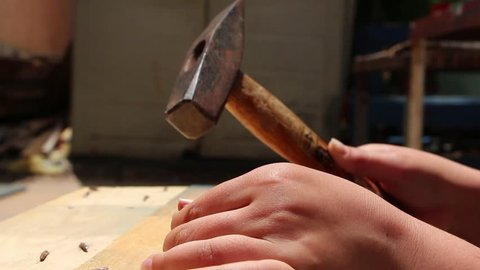 Failed attempt to hit a nail with a hammer on DIY course