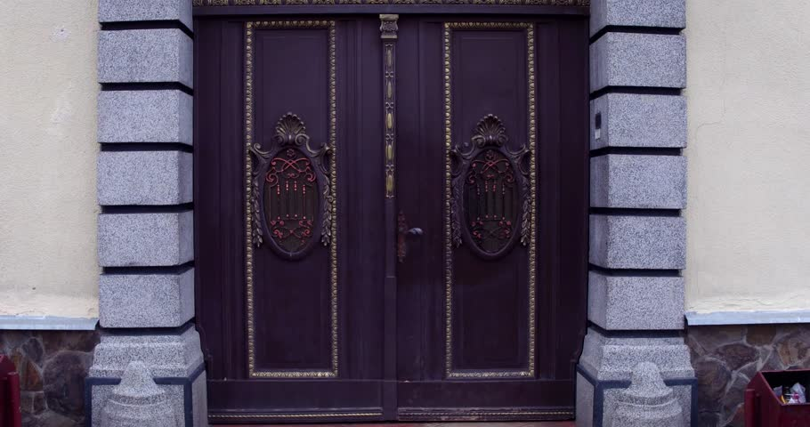 Ancient wooden doors on the street 4k