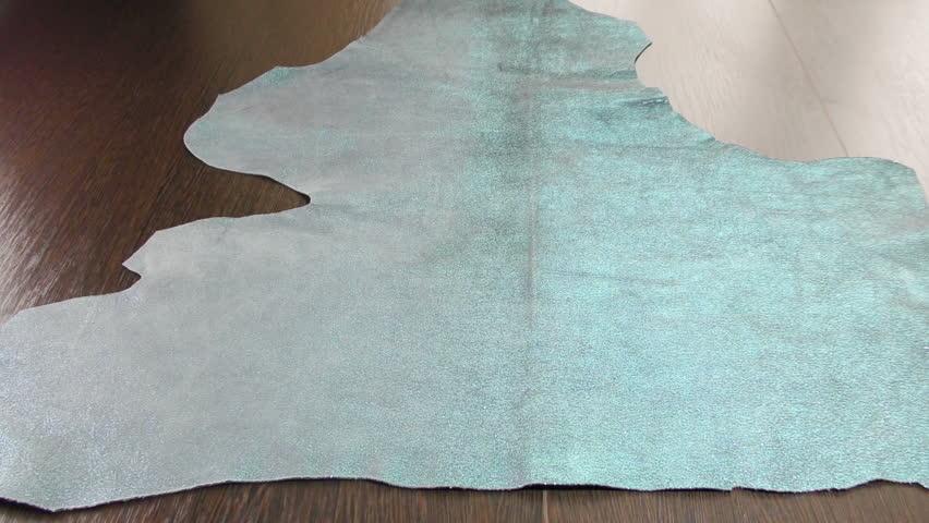 Silver-blue leather of sheepskin. Skin sheepskin with shine. Hides