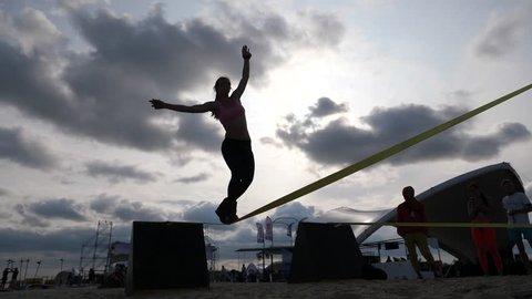 Young Girl Silhouette Walk On A Slackline Balancing Rope The Modern Sport Activity