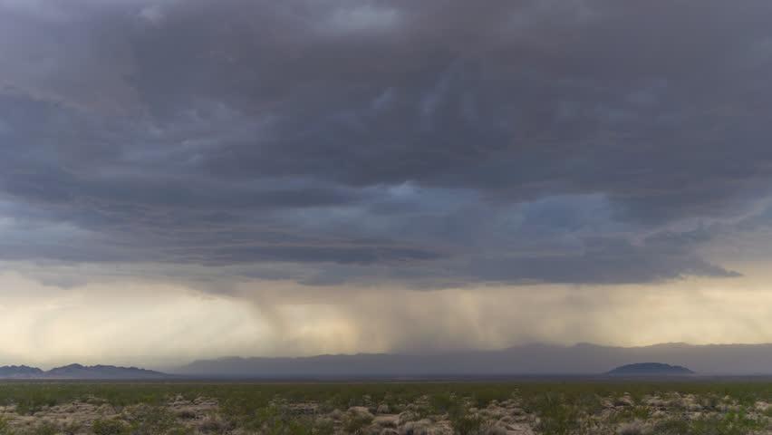 Thunderstorm Mojave Desert with Distant mountains 4K from 6K source -1 Genuine lightning strike | Shutterstock HD Video #30764311