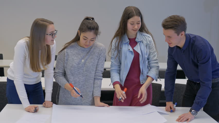 Creative college students making a project in a team. Group of teenagers collaborating while studying in the classroom.   Shutterstock HD Video #30809815