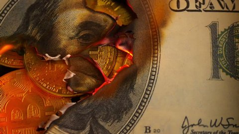 Dollar bill USA money burning. Financial concept with golden Bitcoins end  Benjamin Franklin portrait from 100 dollars banknote.