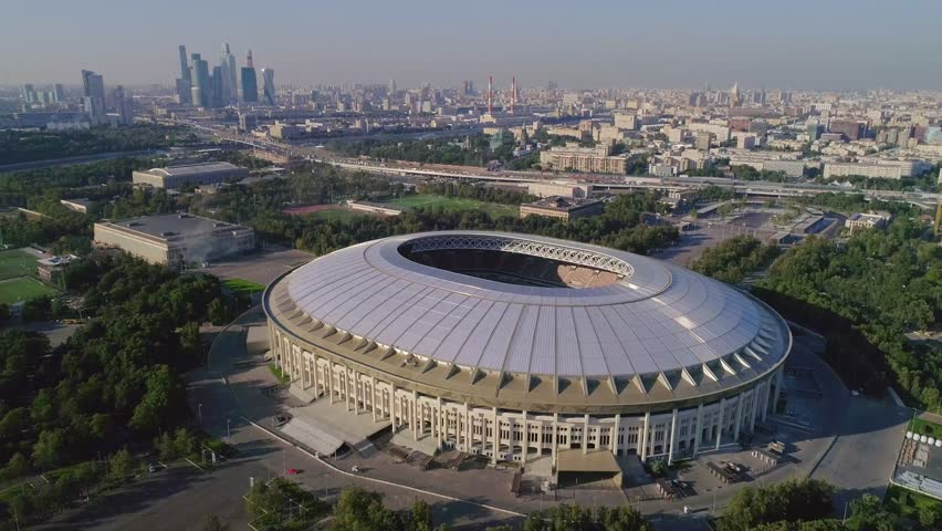 Slow steady cam fly over the main stage of FIFA World Cup 2018. Luzhniki stadium aerial footage. Autumn 2017 actual situation of Moscow stadium construction.