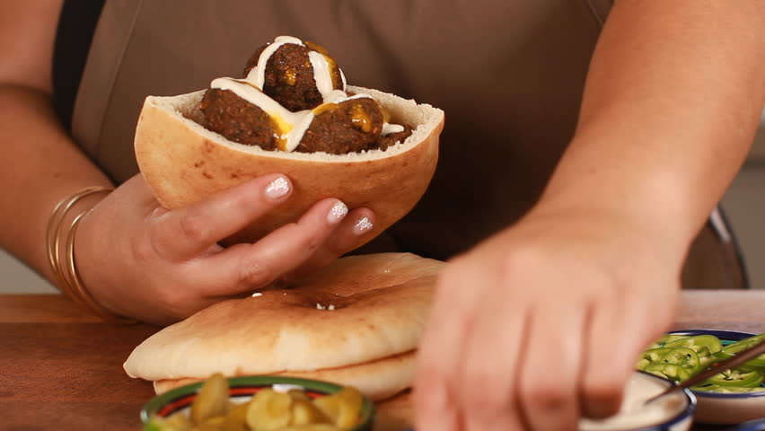 Female chef's hands cook Falafel or felafel deep-fried ball made from ground chickpeas Tahini Middle East   Shutterstock HD Video #30859495