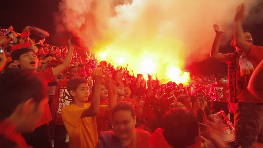 KUALA LUMPUR - MAY 12, 2014: Malaysia football fans using flares and smoke bomb during local league game.