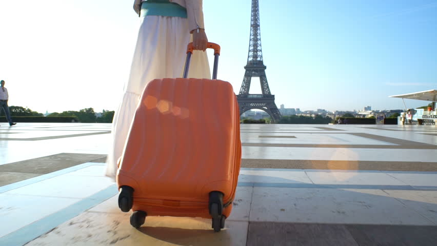 Young Woman with the Orange Suitcase Traveling to Paris. Eiffel Tower Background. | Shutterstock HD Video #30867865