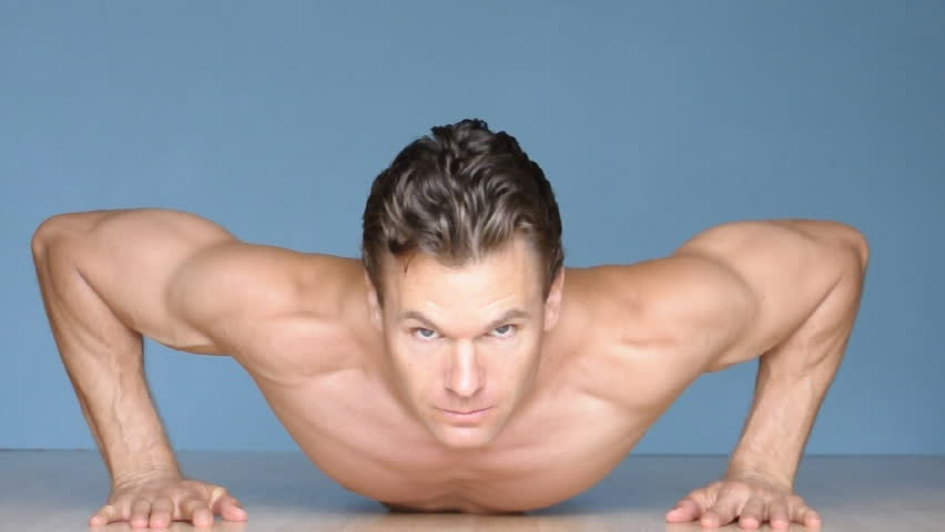 Male athlete performs modified and regular pushups